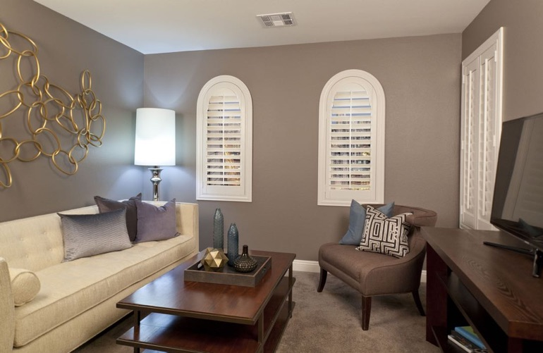 Honolulu family room with arced plantation shutters.