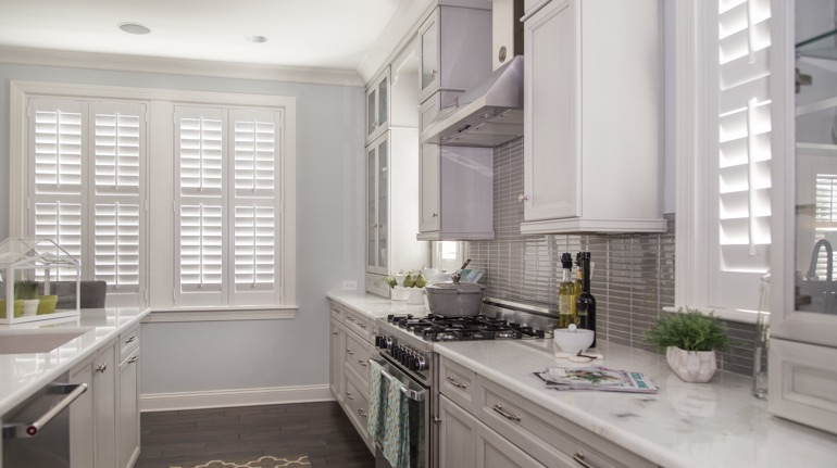 Polywood shutters in Honolulu kitchen with marble counter.