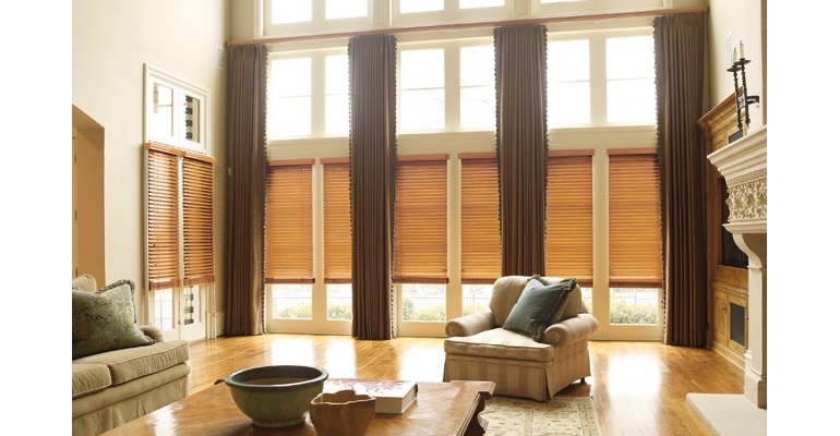 Honolulu great room with wood blinds and full-length draperies.