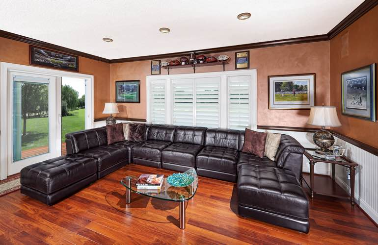 Honolulu basement with glass doors and plantation shutters.