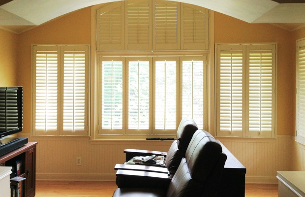 Honolulu plantation shutters in entertainment room