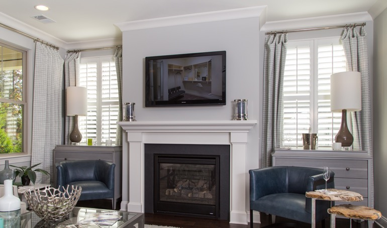 Honolulu fireplace with white shutters.