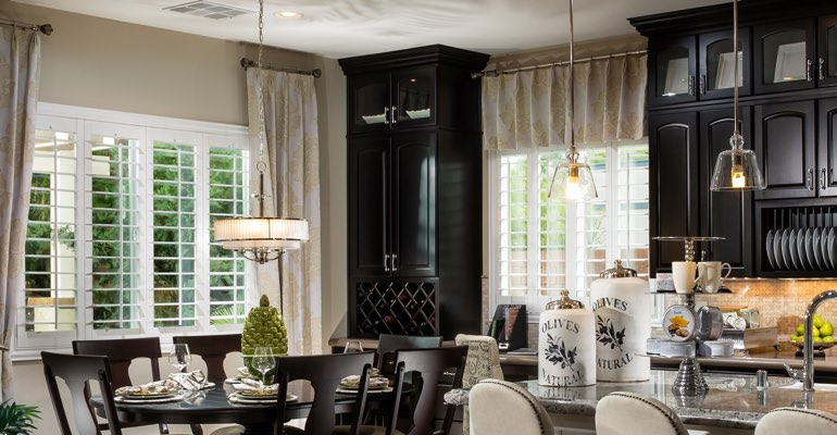 Honolulu kitchen dining room with plantation shutters.