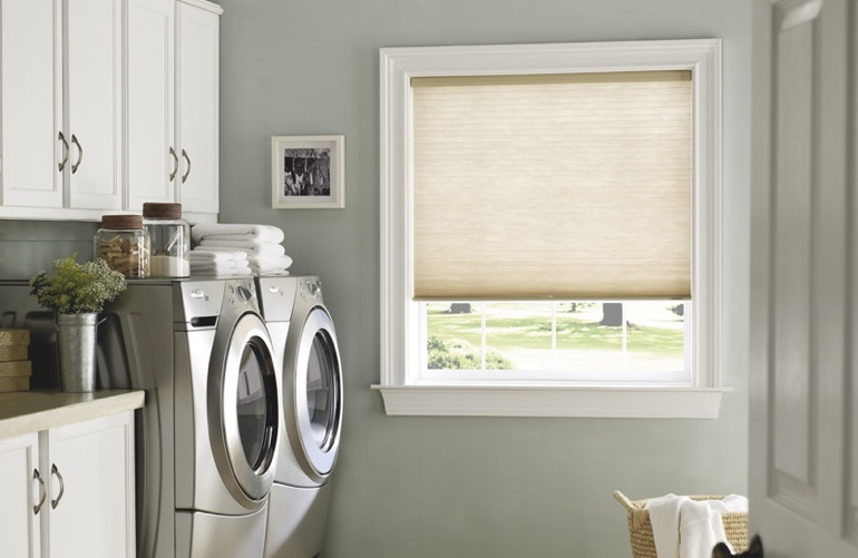 Honolulu laundry room with tan window shades.