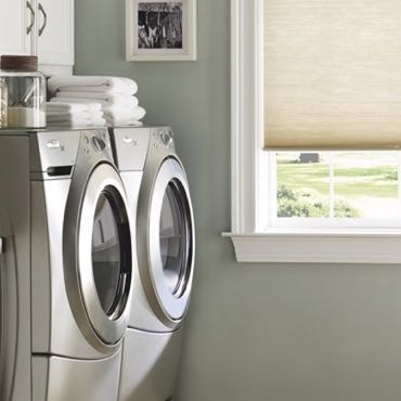 Honolulu laundry room cellular shades.