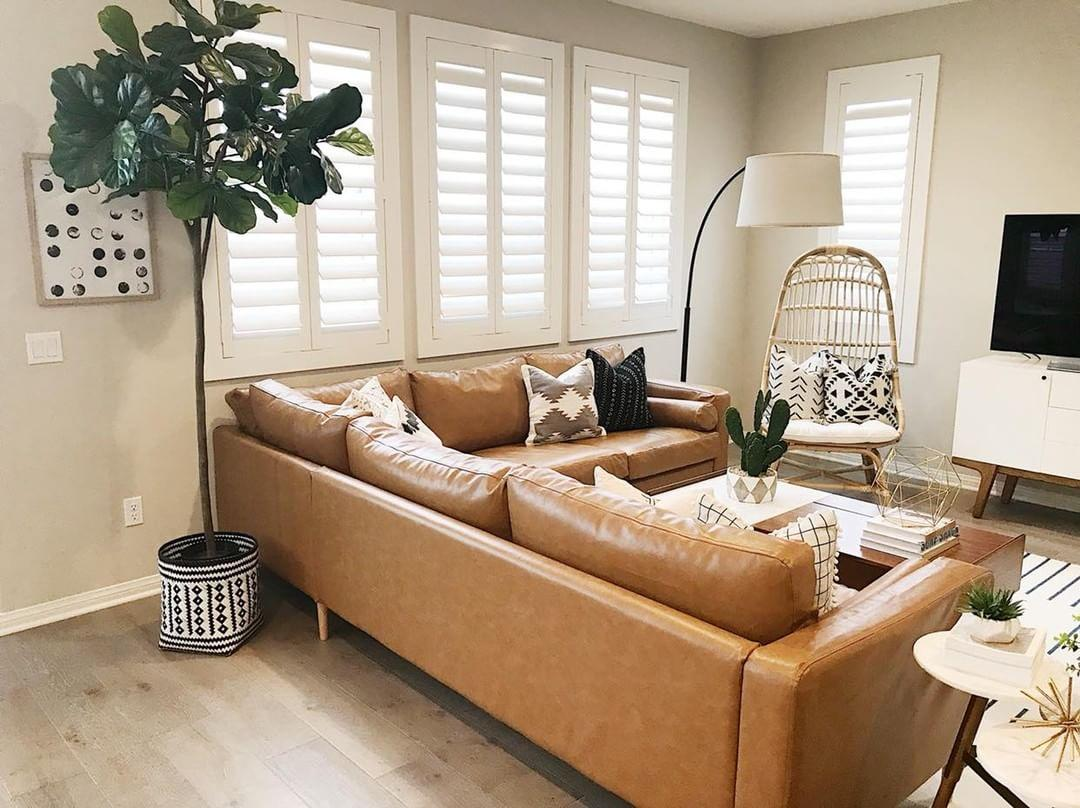 Warm living room with Polywood shutters in Honolulu.