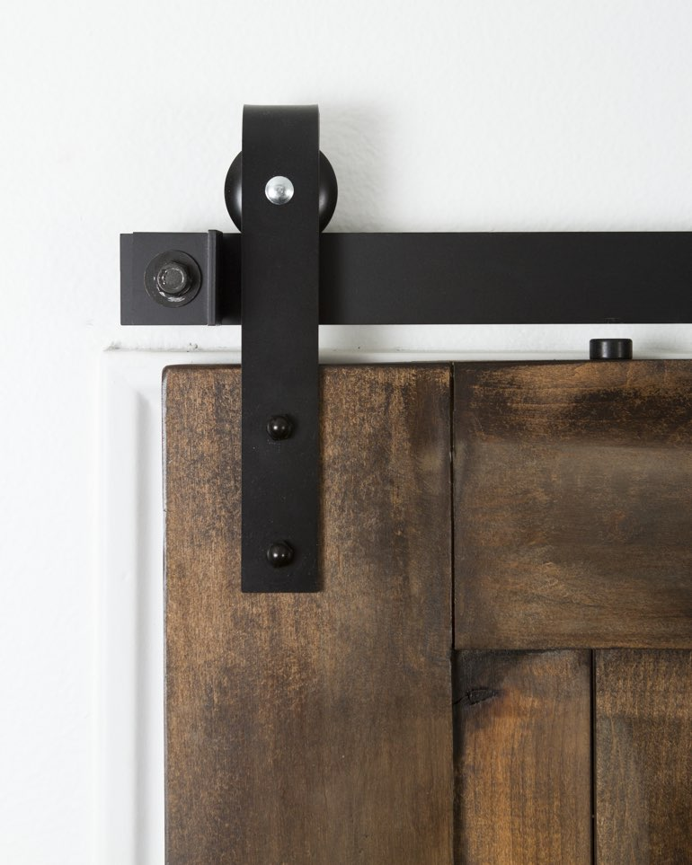 Black mini industrial hanger on brown barn door