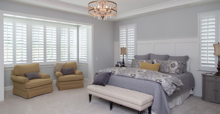 Plantation shutters in Honolulu bedroom.
