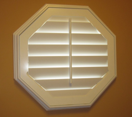 Honolulu octagon window with white shutter