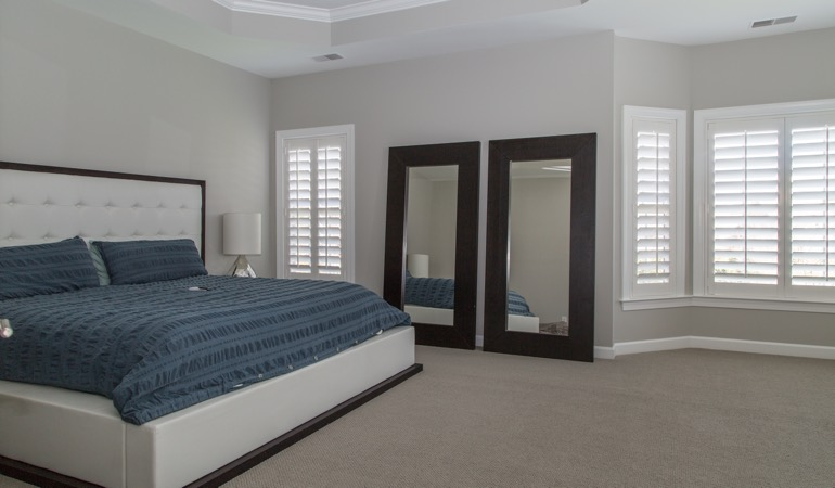 White shutters in a minimalist bedroom in Honolulu.