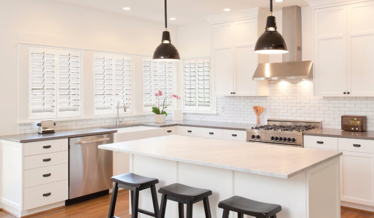 Plantation shutters in a bright Honolulu kitchen.