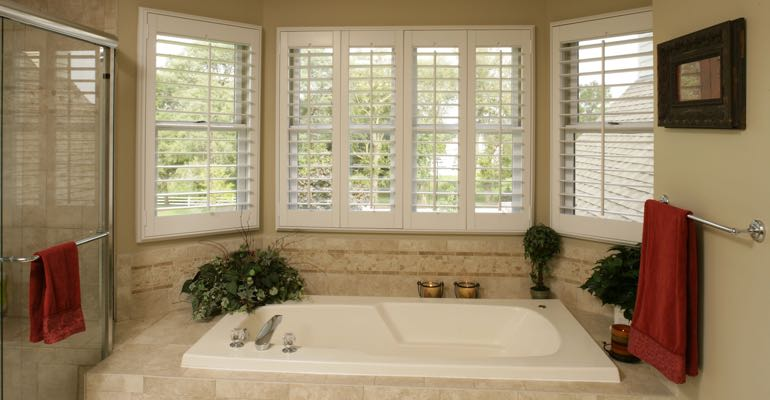 Plantation shutters in Honolulu bathroom.
