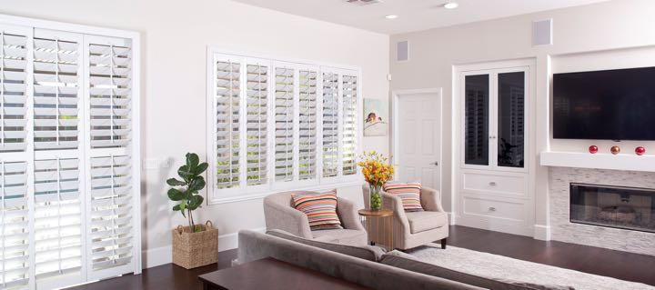 Honolulu living room in white with plantation shutters.