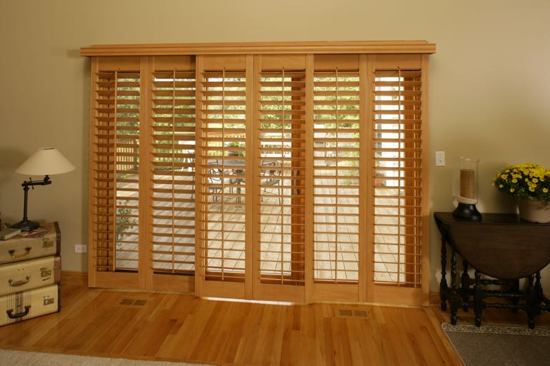 plantation shutters on sliding door going to full porch.