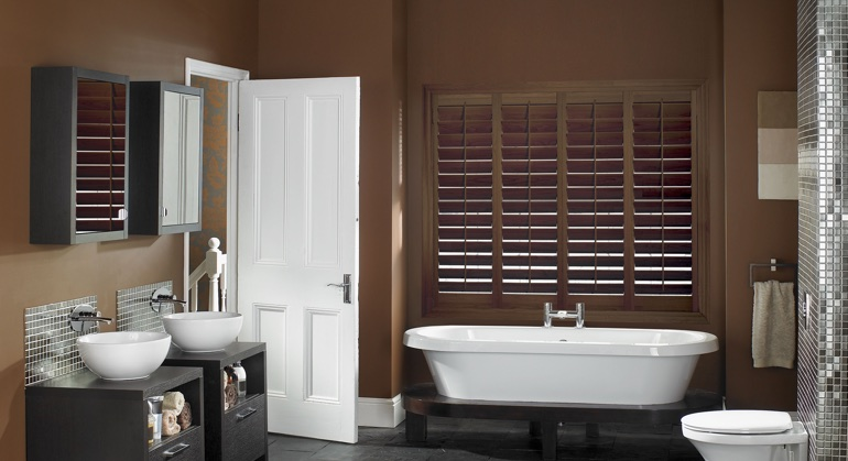 Stained wood shutter in Honolulu restroom