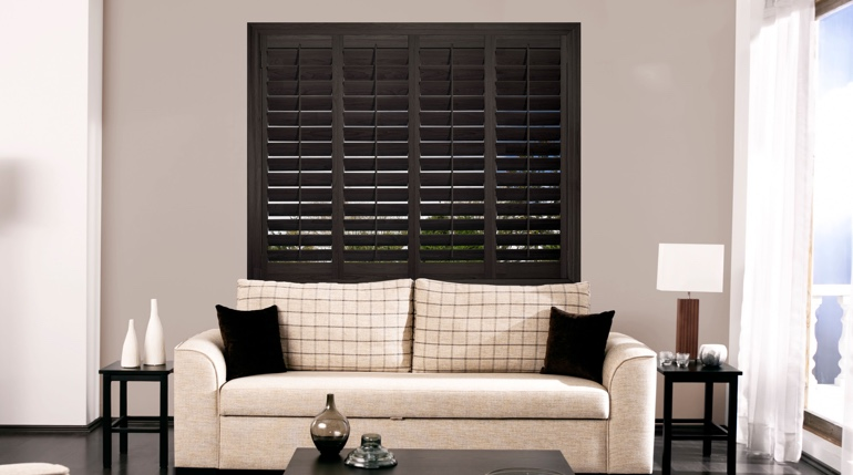 Honolulu sitting room with plantation shutters.