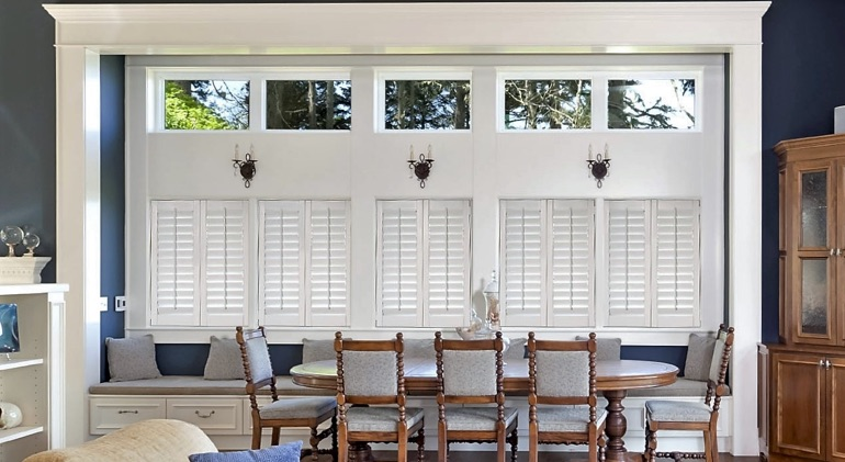 Shut white plantation shutters in Honolulu great room.