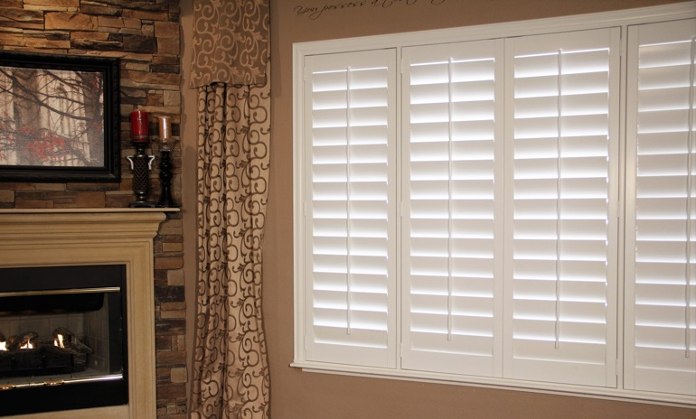 Honolulu Studio plantation shutters in family room.