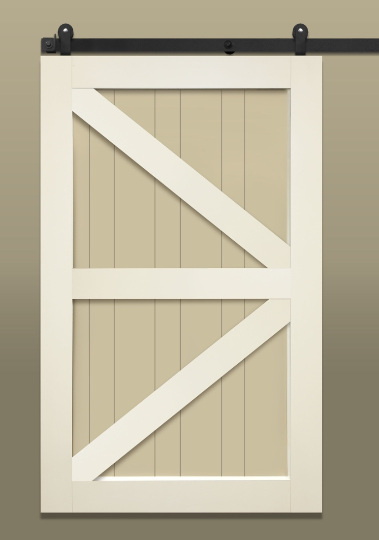Light colored sliding barn door with British brace