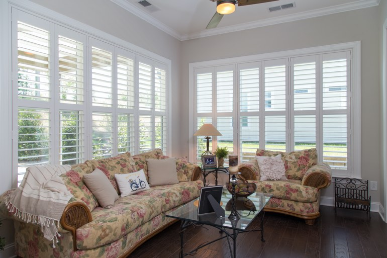 Airy sunroom with faux wood shutters in Honolulu.