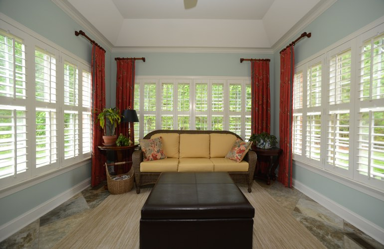 Honolulu sunroom with white window shutters.