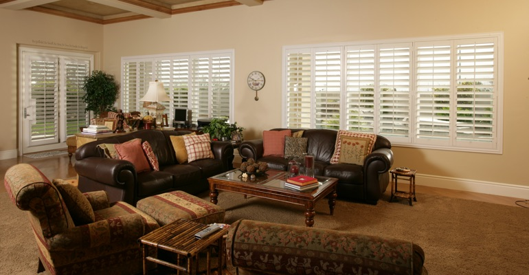 Honolulu sunroom with white shutters.