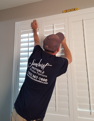 Shutter installation in Honolulu bedroom.
