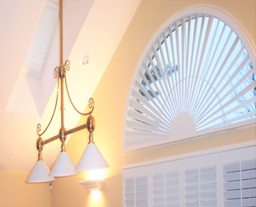Honolulu arched eyebrow window with custom shutter
