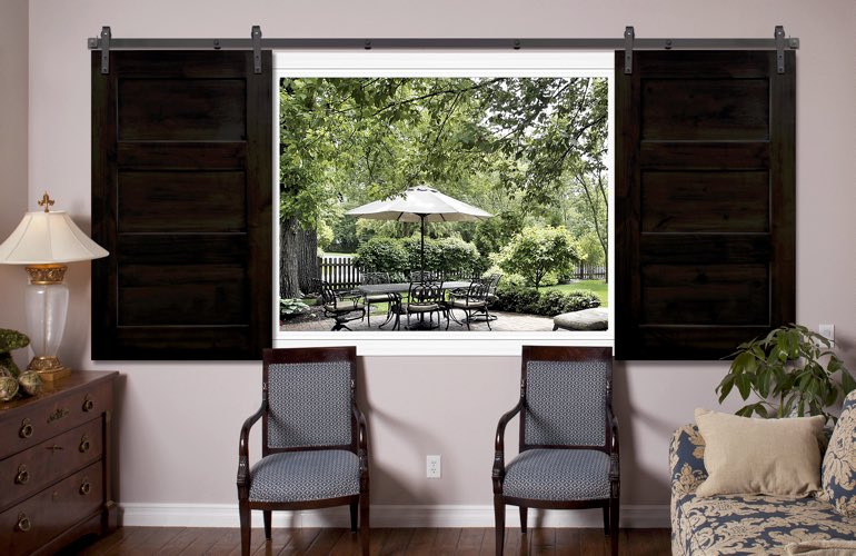 Dark brown sliding barn door shutters in living room