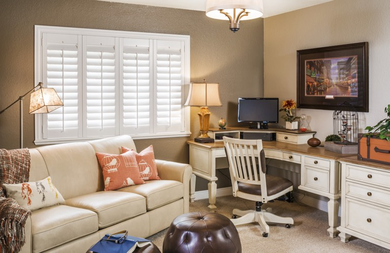 Honolulu home office with white window shutters.