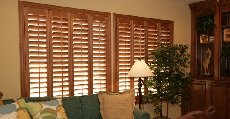 Wood shutters in Honolulu living room.