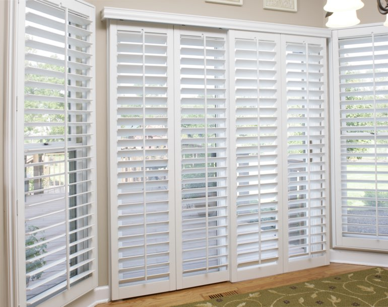 Sliding glass door with white shutters Honolulu